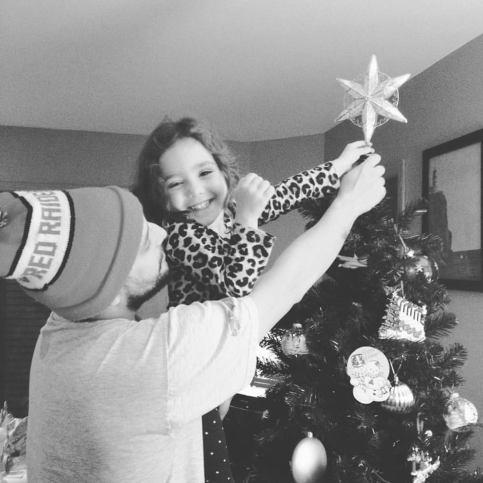 putting star on tree 2015.jpg